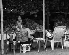 Breaktime (Beegee49) Tags: street market stall fruit vegetables vendor family girl eating silay city philippines