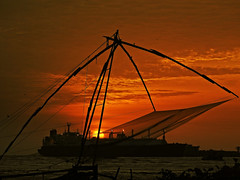The dusk divine !! (Lopamudra !) Tags: lopamudra lopamudrabarman lopa india sunshine sunset twilight sundown sunlight dusk evening fishingnet fishing silhouette divine colour color colours colourful kochi cochin nightfall lightandshade light shadow shade nature kerala structure ship arabian arabiansea sea ocean water waterscape clouds cloud sky skyscape beauty beautiful picturesque