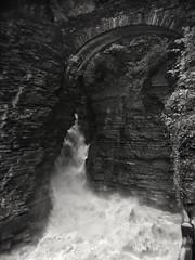 Gushing Waters at Watkins (LJS74) Tags: rain badweather monochrome bw blackwhite blackandwhite stonebridge landscape storm flowingwater sentrybridge watkinsglenstatepark entrancefalls waterfalls falls