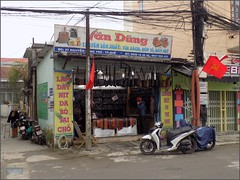 Vietnam, Hue City Văn Dũng 20180213_093434 DSCN3165 (CanadaGood) Tags: asia asean seasia vietnam vietnamese hue building shopping leather sign advertising powerlines canadagood 2018 thisdecade color colour