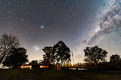 The Milky Way and Magellanic Clouds (Merrillie) Tags: night glitter landscape winter astrophotography australia rural magellanicclouds newsouthwales astro paddock nightsky gresford country road outside largemagellaniccloud astrology milkyway astronomy sky tree nsw stars outdoors smallmagellaniccloud