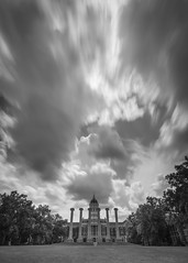 The Columns and Jesse Hall Monochrome (Notley Hawkins) Tags: httpwwwnotleyhawkinscom notleyhawkinsphotography notley notleyhawkins 10thavenue haida mizzou columns thecolumns jessehall campus universityofmissouri columbiamissouri bocomo boonecountymissouri july afternoon sky clouds cloudysky nd ndfilter neutraldensity neutraldensityfilter longexposure grass tree francisquadrangle nisi nisifilter 10stop blackandwhite monochrome