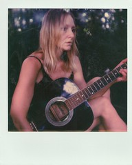 the forlorn look on my face is most likely due to the fact that just before this shot,  I had my camera set up in a tree with a much better anx comprehensive view, but my camera fell out the tree of course,  then I fell trying to catch it which led to me (Britt Grimm) Tags: polavoid polaroid polaroid600 i1 polaroidoriginals impossibleproject impossibleprojectfilm instantfilm instantphotography believeinfilm filmisnotdead filmphotography analoguephotography analogue analog guitar