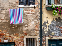 Wash Day Venice (derek.dpr) Tags: venice venise venezia towel washing drying line striped decay decaying olympus omd em5 streetview streetscene urban