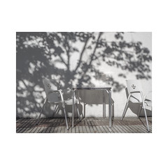 Not enough shadow...  ( Pamplona ) (José Luis Cosme Giral) Tags: notenoughshadow minimalism urbannature shadow light terrace wall chairs textures olympus pamplona navarra