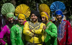 A Colourful and Vibrant World (Leanne Boulton) Tags: glasgowmela2018 people costume urban street candid portrait portraiture groupshot streetphotography candidstreetphotography candidportrait streetportrait streetlife event glasgowmela multicultural festival man men male face faces expression posture pose beard moustache turban indian colourful bright yellow pink green red blue headdress pattern fabric style fashion tone texture detail depthoffield bokeh naturallight outdoor sunlight light shade shadow summer city scene human life living humanity society culture lifestyle canon canon5dmkiii telephoto ef70200mmf28lisiiusm color colour glasgow scotland uk kelvingrovepark