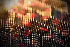 Corrugated ZigZag Mesh (Group Founder) Tags: macromondays mesh macromondaymesh nikon nikond3200 macro meshart bokeh brokenart dof vignette colourful black red gold light metal metalmesh multicolor