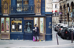 Boots, book and a beret. (roughtimes) Tags: 201710075404copy boots book beret paris shoppe tourist picture street photography old school blue victorian era