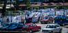 2018 - Serbia - Donji Milanovac - Embroidery Market (Ted's photos - For Me & You) Tags: 2018 cropped nikon nikond750 nikonfx serbia tedmcgrath tedsphotos vignetting red redrule vehicles cars bollards streetscene market dacia