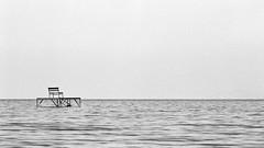 Lake... (lupuszka) Tags: lake waves horizont waterfront about water marine pier monochrome blackandwhite bw analog film ilford ilfordfp4 fp4 nikonfe grain balaton hungary