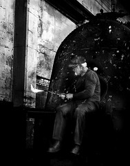 024693763647-103-Working on the Train-6-Black and White (Jim There's things half in shadow and in light) Tags: america ely nevada nevadanorthernrailwaymuseum southwest usa whitepinecounty history locomotive museum rail steam welding work man person blackandwhite