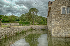 Ightham Mote - West Side (Geoff Henson) Tags: house manor mansion moat mote walls garden plants flowers water reflection clouds historic duck