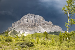 Storm clouds over Crowsnest Mtn (Canon Queen Rocks (2,193,000 + views)) Tags: stormclouds mountain crowsnestmountain tree grass greens rocks nature alberta landscape landscapes sky scenery scenic stormy canada momentsbycelinecom mountainside trees