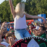 Soccer fans throwing a girl in the air thumbnail