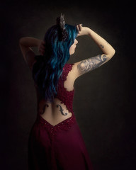 Dance of the Damned (Giulia Valente) Tags: portrait portraiture woman beauty beautiful alone cinematic cinema movie story romance romantic one looking light shadow dark beam darkness mood moody atmosphere low key dream inspiring dance damnation damned evil queen fallen angel tattoo blue hair