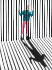 Untitled (KevinBJensen) Tags: bw minimal black white girl fence gate staves shadow light dark amelie satzger stephen hawking