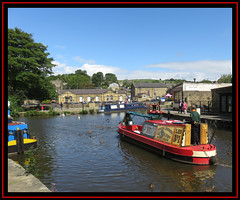 Skipton. Trip Boat (M E For Bees (Was Margaret Edge The Bee Girl)) Tags: skipton leedsandliverpoolcanal town narrowboats water sun summer blue sky reflections outdoors red buildings grey stone canon ducks tree