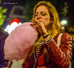 Candyfloss (Robica Photography) Tags: robicaphotography streetphotography straatfotografie streetart 2018 tilburg markt avondmarkt nachtmarkt meimarkttilburg evening dim streetlights pavement woman d3200 long hair lady young candyfloss eating candy sugar red jacket leather blonde pink