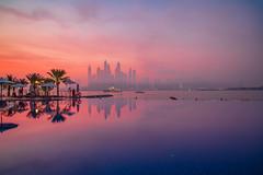 ..Turning Tables.. (SpaceCadet37) Tags: dubai canon sunrise reflections architecture mariobekes mariobekesphotography palms ocean beach clouds sky uae emirates thepalmjumeirah