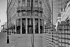 < < < mirrored > > > (christikren) Tags: austria architecture blackwhite bw building christikren downtown glass monochrome noiretblanc österreich panasonic photography reflection sw vienna mirror spiegelung street wien windows pedestrianzone reflets mono