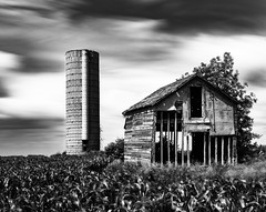 Decaying Farm (CanonDLee) Tags: barn clouds country dynamic farm field leesuperstopper longexposure mn minnesota rural silo sky texture