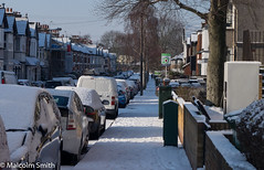 Sold Boards In Woodland Road (M C Smith) Tags: pentax k3 pavement snow boards sold building letters symbols cars van white parked parking fridge waste wall fence shadows trees branches telegraphpoles wires footprints sky blue walking steps railings black hedge bins