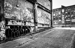 IMG_8098 (Kathi Huidobro) Tags: londonstreets facades blackwhite bw monochrome london graffiti texture factories industrial urbandecay derelict abandoned architecture