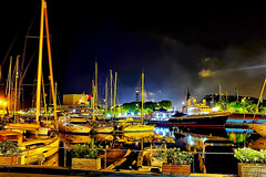 Barceloneta nights (Fnikos) Tags: port puerto porto harbour harbor sea water waterfront sky skyline cloud architecture building boat sailboat ship light reflection tree plant nature night nightview nightshot outdoor