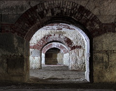 Concentric Combustion (95wombat) Tags: old military fortress corridor darkness light shadow decayed crumbling georges island fort warren boston harbor massachusetts