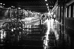 under Central Station (Chilanga Cement) Tags: fuji fujix100f x100f 100f bw blackandwhite xseries street night reflection reflections reflecting reflective waterreflection glasgow glasgowcentralstation perspective