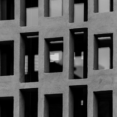Il ritmo di un istante. The rythm of an istant B&W (abstract reality/reflections)) (sandroraffini) Tags: muro wall grigliato grid bricks finestrine small windows rettangoli parallelogrammi rectangles luce ombra light perspective prospettiva vetro glass riflessi reflections abstract reality realtà astratta ritmo rythm scintillio twinkle bw canon eos80d 70200 raw monteveglio crespellano exploration rurale rural industrial turismo tourism grigio grey shades tonalità minimalismo minimalism superfici surfaces geometria geometry decoration shadows new old sovrapposizione superimposition vecchio nuovo infraspazio infraspaces