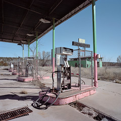 ted's bull pen / route 66. ash fork, az. 2015. (eyetwist) Tags: eyetwistkevinballuff eyetwist ashfork route66 arizona diesel truckstop abandoned mamiya 6mf 50mm kodak portra 160 mamiya6mf mamiya50mmf4l kodakportra160 ishootfilm ishootkodak analog analogue film emulsion mamiya6 square 6x6 mediumformat 120 filmexif iconla epsonv750pro filmtagger 6 williams desert highdesert motherroad us66 route 66 truck trucking truckers garage gas gasoline fuel petrol pump service station derelict ruins ruin roadside america americana typology i40 rusty rusted shadow tedsbullpen pink canopy overgrown weeds