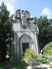 IMG_7496 (Brechtbug) Tags: roof sitting angel clutching sword above mausoleum entrance granite greenwood cemetery statue wings graveyard tomb horn tombstone crypt mausoleums angels swords seated green wood brooklyn new york city 2018 nyc located corner border ave sassafras 08122018