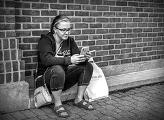 Street Portrait Project..... (Kevin Povenz Thanks for all the views and comments) Tags: 2018 june kevinpovenz westmichigan michigan holland ottawa ottawacounty street streetphotography streetportrait girl female woman blackandwhite bw portrait canon7dmarkii sigma24105art phone smoke smoking cigarette wall brick sitting bag glasses