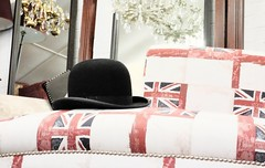 Establishment. (ianmiller6771) Tags: unionjack bowlerhat chair establishment unitedkingdom symbolism fujixt1 35mm pattern junkshop tradition bygoneage mirrors chandelier fuji