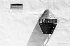A Lamp (languitar) Tags: lamp canaryislands lanzarote building photography house fundacióncésarmanrique colors blackwhite wall tahiche spain white españa islascanarias kingdomofspain reinodeespaña lens:maker=nikon lens:aperture=40 lens:focallength=24120 lens:type=afsnikkor24120mmf4gedvr