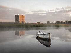 Threave Castle Dawn ( IN EXPLORE) (zico1965) Tags: dawn sunrise reflection threave castle boat water sky tones morning still calm mist clouds warm