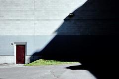 Someone Waiting at the Door (SebRiv) Tags: imagination story wolfe disproportion door cle minoltacle shadow kodakektar100 ektar100 monster