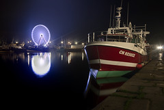 "work and play, long exposure of the two faces of Honfleur, trawler and Ferris Wheel at night, Honfleur, Calvados, Normandy, France (grumpybaldprof) Tags: ""ferriswheel"" ""placedelagare"" ""lagranderoue"" ""lamorelle"" ""morelleriver"" ""bassindel'est"" ""eastharbour"" trawler chalutier ""fishingboat"" ""bateaudepeche"" honfleur normandy normandie france calvados ""rivierelamorelle"" ""quaidelajeteedel'est"" ""honfleurharbour"" ""portduhonfleur"" stack dualexposure ""fineart"" striking artistic interpretation impressionist stylistic style contrast shadow bright dark black white illuminated colour colours ""longexposure"" ""dark night nocturne nighttime ""lowlight"""