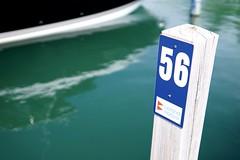 Slip 56, Leland Harbor, MI, 2018 (Tom Powell) Tags: leland marinas leelanau lakemichigan michigan 2018 sonya6000 sigma30mmf14dcdn reflections selectivefocus