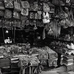 Market Stall, Aguas Calientes, Peru (austin granger) Tags: aguascalientes peru market stall booth souvenir momentos tourist shop incatrail square film gf670 vendor