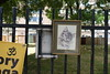21st June 2018 (themostinept) Tags: streetart railings marquessestate london picture painting illustration cat frame pictureframe sign signs trees leaves grass essexroad islington n1 newrivergreen