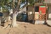 Near Grand Avenue (GC_Dean) Tags: phoenix arizona frontyard tree dirt frontporch wood shadows house home fence wall blockwall door street emptiness mundane city cityscape urban urbanlandscape sociallandscape space colors color colours structure building flora