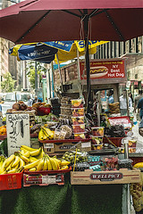 "Candid of Outdoor Sidewalk congestion in Manhattan (nrhodesphotos(the_eye_of_the_moment)) Tags: dsc024773001084 ""theeyeofthemoment21gmailcom"" ""wwwflickrcomphotostheeyeofthemoment"" food sign nyc manhattan people veggies fruits carts metal candid street outdoors umbrella"