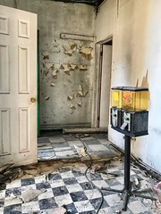 """I was convinced that entry into this abandonment would gain me access to a place I have been drooling over since March 2015. Saldy, this was my own version of Geraldo Rivera's """"Mystery of Al Capone's Vaults."""" Finding empty candy machines was quite poetic. (neilsharris) Tags: abandonedchicago"""