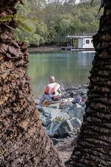 The fisherman (idunbarreid) Tags: fisherman rocks houseboat