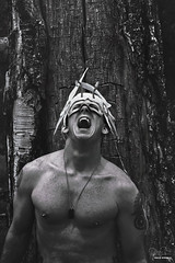 Pan's  Battlecry (Philip Bonneau) Tags: pan peterpan fairy mask costume tree wood bark man shirtless tattoo chest screaming anger portrait emotion conceptual dogtag war outdoors prisoner texture naked muscular