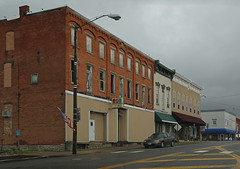Buildings — Attica, Ohio (Pythaglio) Tags: building structure buildings structures commercial brick threestory attica ohio senecacounty 11windows stone lintels sills altered remodeled storefronts corbelling corbelled awning sidewalk cars clouds