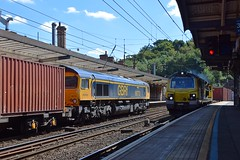 A busy morning at Ipswich sees the Felixstowe - Birch Coppice Intermodal on the left with 66712 and coming the opposite way, 70014 hauls the Coatbridge - Felixstowe Freightliner service. 01 08 2018 (pnb511) Tags: loco locomotive engine diesel train engines diesels class66 gbrf freightliner class70 containers freight station platform trains railway greateasternmainline geml