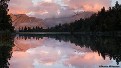 Lake Matheson Sunset (Marcia H) Tags: newzealand westcoast southisland lakematheson mountains sunset water lake trees